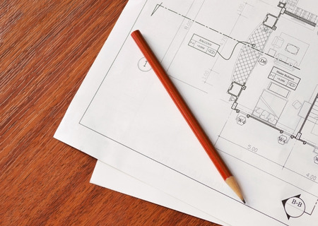 architect plan with pencil on top,wood background photo