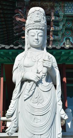 quan yin buddha scupture make by white stone photo