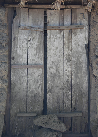 permanently: Old wooden door at jeju korea close permanently,local art & culture of korea