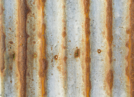 Rusty corrugated metal material,rusty Zinc grunge texture photo