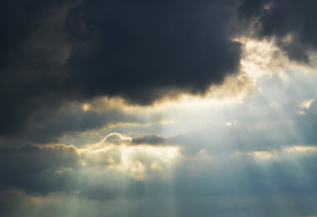 stab: cloud with sun rays are stab through