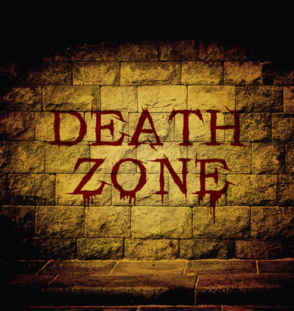 cutthroat: death zone blood text at the brick wall with dim light