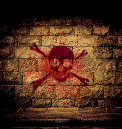 cutthroat: skull blood paint at the brick wall with dim light Stock Photo