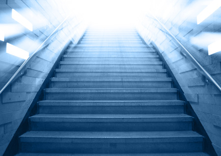 divinity: tunnel Staircase going up to the light,abstract cool blue monotone Stock Photo