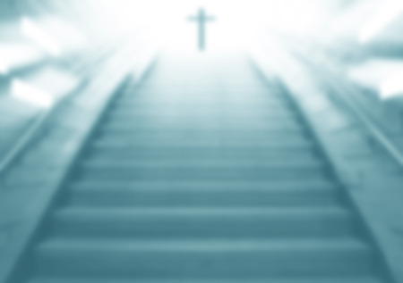 Staircase going up to the Christian religious cross with cool light,blurry scene same dream