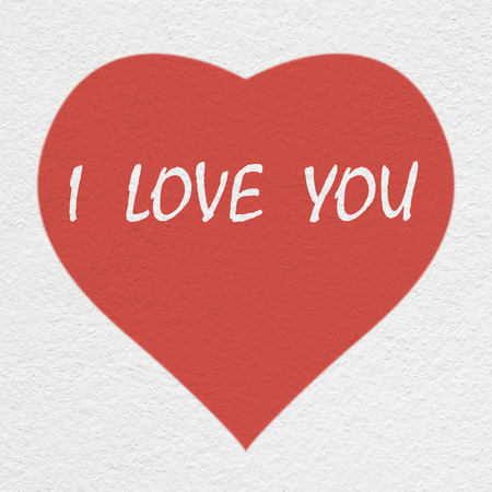 heart painting with i love you text on the white wall
