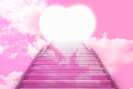 stairway going up to the hearts with pink sky background