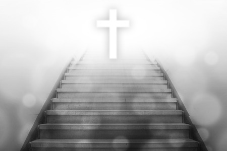 stairway going up to the christian cross with bokeh light background,gray color tone