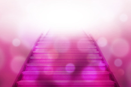 stairway going up to white light with bokeh light background,pink color tone Stockfoto