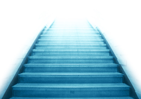 Staircase going up to the white light with isolated background,blue color monotone picture