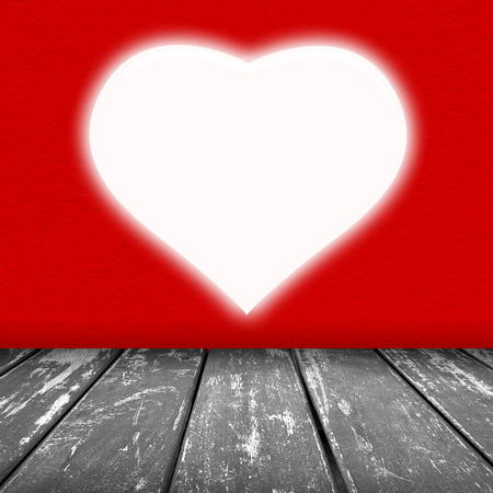 red wall texture with white heart void with light background and wood floor grey color Imagens