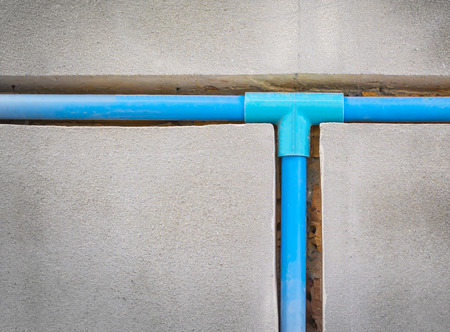 bury a pvc pipe in the wall,sanitary system installation photo