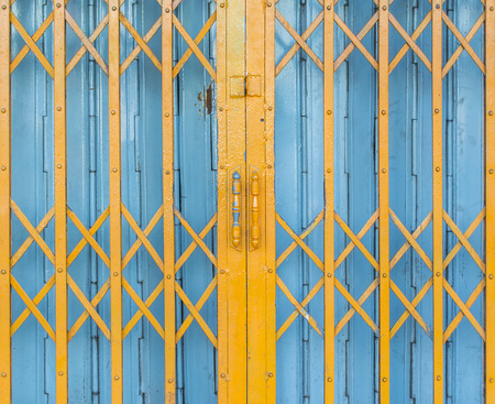 old yellow and blue steel door background photo
