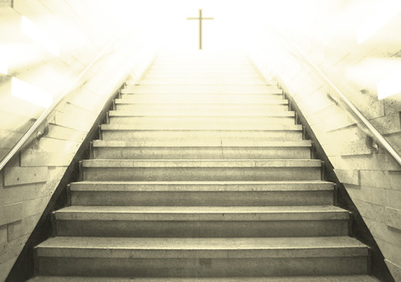 heavenly light: Stairs leading up to the cross with the light out Stock Photo