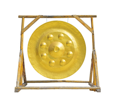 exotic gleam: Large golden gong with isolated background Stock Photo