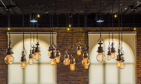 vintage tungsten light with brick wall and window background,interior loft style Archivio Fotografico