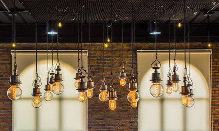 lightbulbs: vintage tungsten light with brick wall and window background,interior loft style Stock Photo