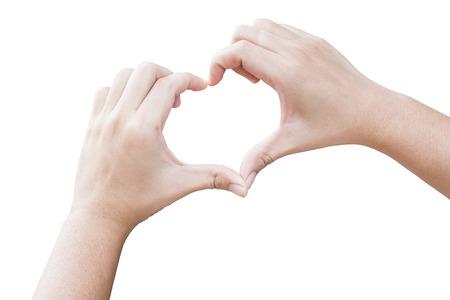 corazon en la mano: manos en forma de corazón con el fondo aislado Foto de archivo