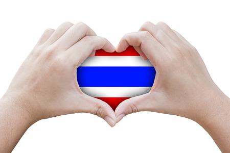 handen in de vorm van hart met symbolen van de vlag van Thailand, geïsoleerde achtergrond
