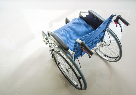 A wheelchair with a light on floor, top view photo