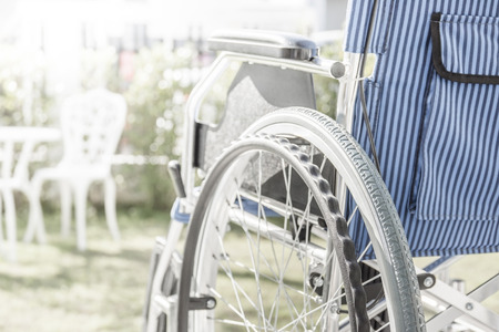 Wheelchairs with light from left in the garden Stockfoto