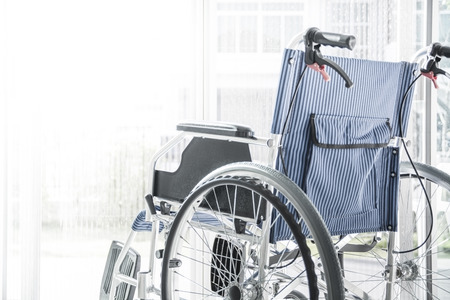 Wheelchairs with light from window,white light for text space on left area