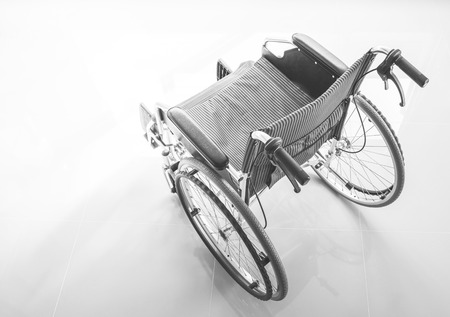 A wheelchair with a light on floor, top view photo, monotone colored processed