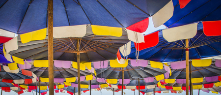 colorful sun umbrellas on the beach,Photography from below, Useful for background about the holidays & etc