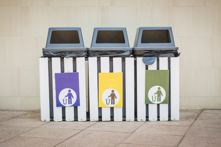 Three bins with 3 color labels on outdoor