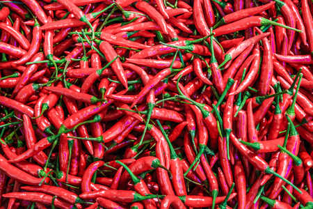 Many red chillis are overlapped, shot from supermarket Stockfoto - 111019255