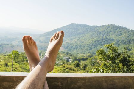 foot with mountain nature background, relax travel concept