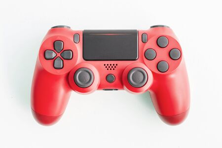 A joystick controller on the white isolated background, red colored