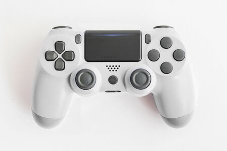 A joystick controller on the white isolated background, White colored