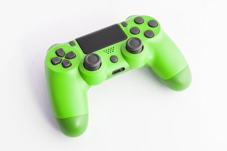 A joystick controller on the white isolated background, green colored Stockfoto
