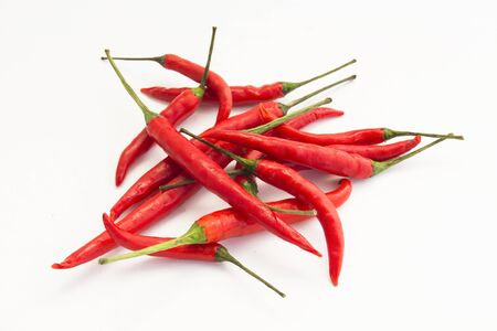 Many red chillis are overlapped, isolated background