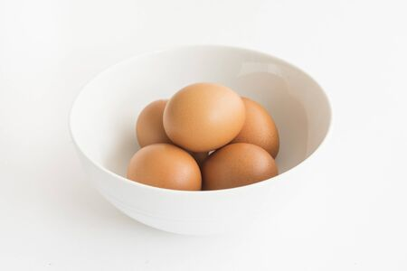 the five eggs on the bowl with white isolated background