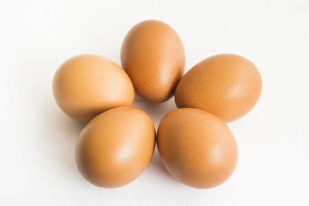 The five eggs on the white isolated background