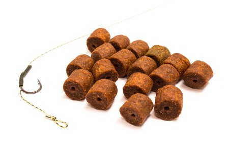 fishing rig: Pellet - Fishing Bait and accessories isolated on white