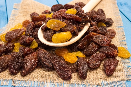 the raisins on a blue board closeup