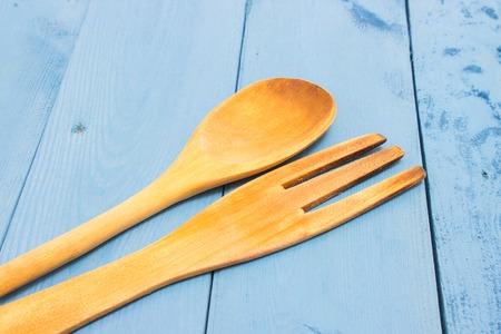 wood craft: kitchen tools on a blue board closeup