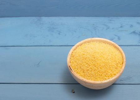 groats: millet groats diet supplements on the blue board
