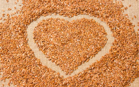 flaxseed: flaxseed on canvas arranged in a heart shape