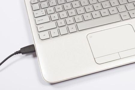 usb port: USB port of a white laptop closeup Stock Photo