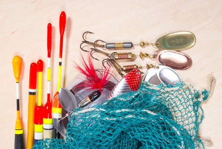 wobbler: bait, wobbler and fishing accessories on wooden background Stock Photo