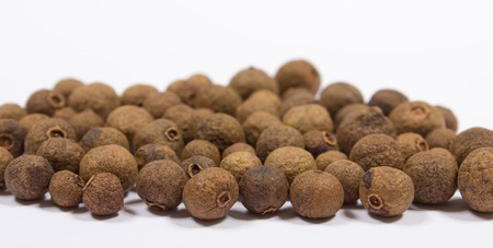 allspice: Grains of allspice isolated on white background