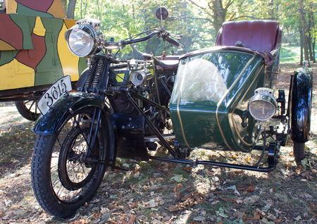 sidecar: Old motorcycle with a sidecar in the forest.