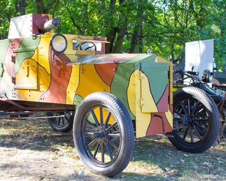 armored car: Armored car from World War I on the forest background.