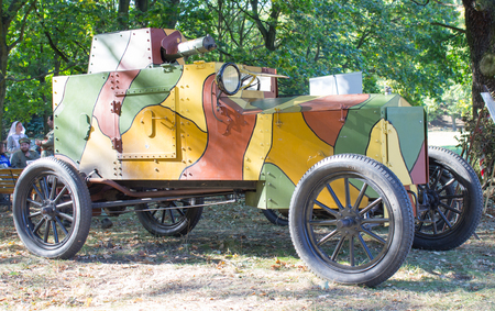 armored: Armored car from World War I on the forest background.