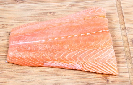unsaturated fat: CloseUp on fresh salmon fillet on a wooden background.