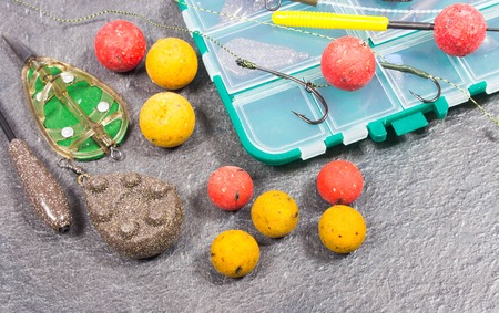 fishing rig: Carp Hook Boilies on black background - close up.